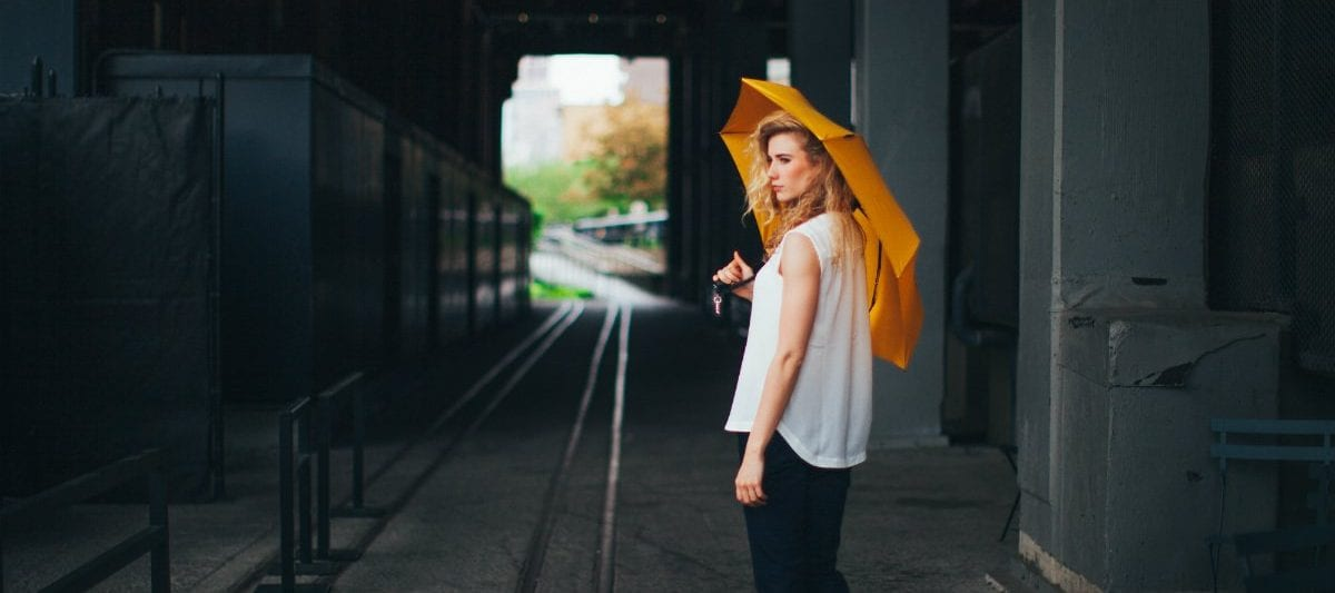 Best Compact Travel Umbrellas Davek Women in Tunnel