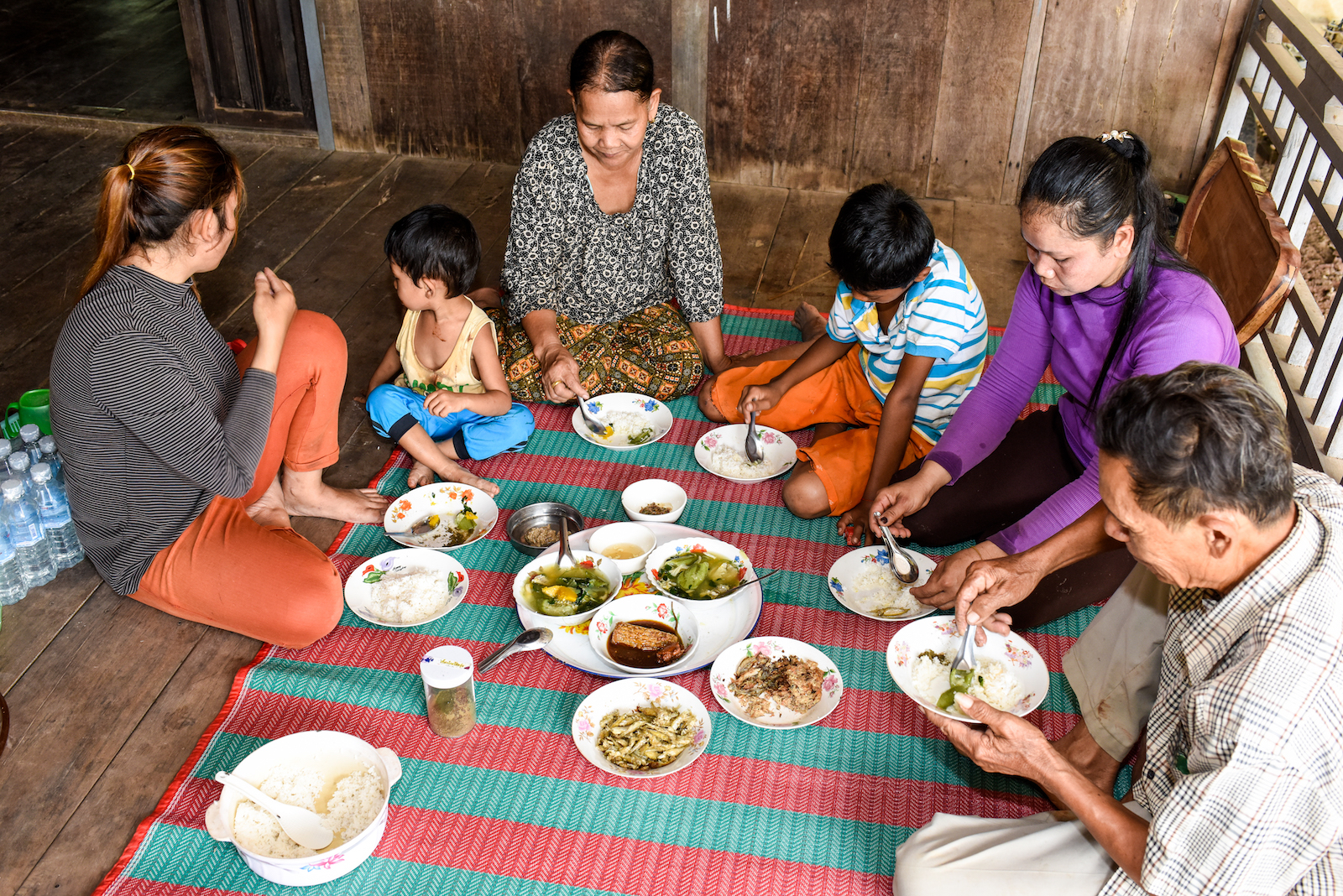 Family having meal in Kralanh District, Siem Reap Province, Cambodia