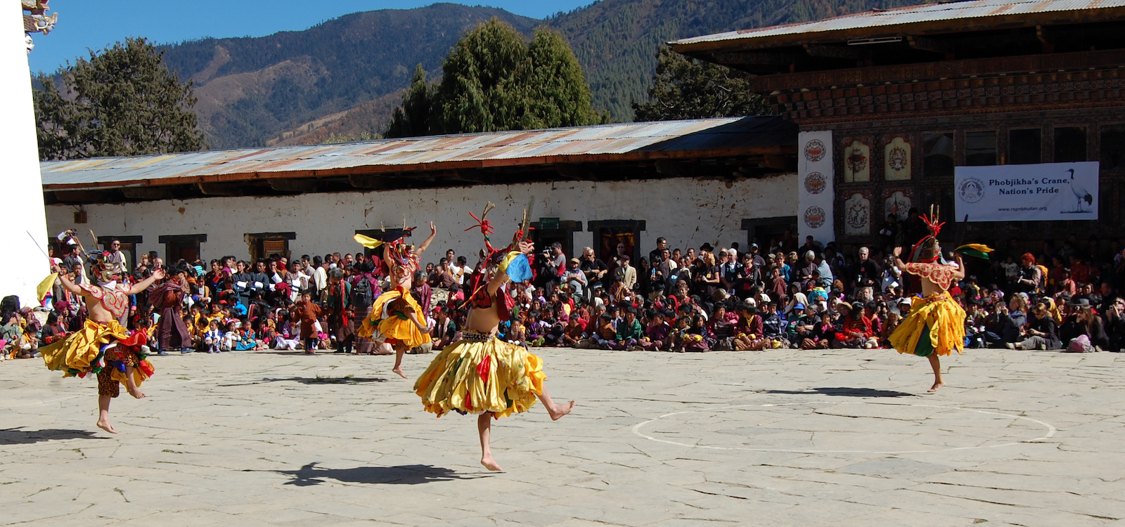dancers at Crane festival Phobjikha Valley, Bhutan