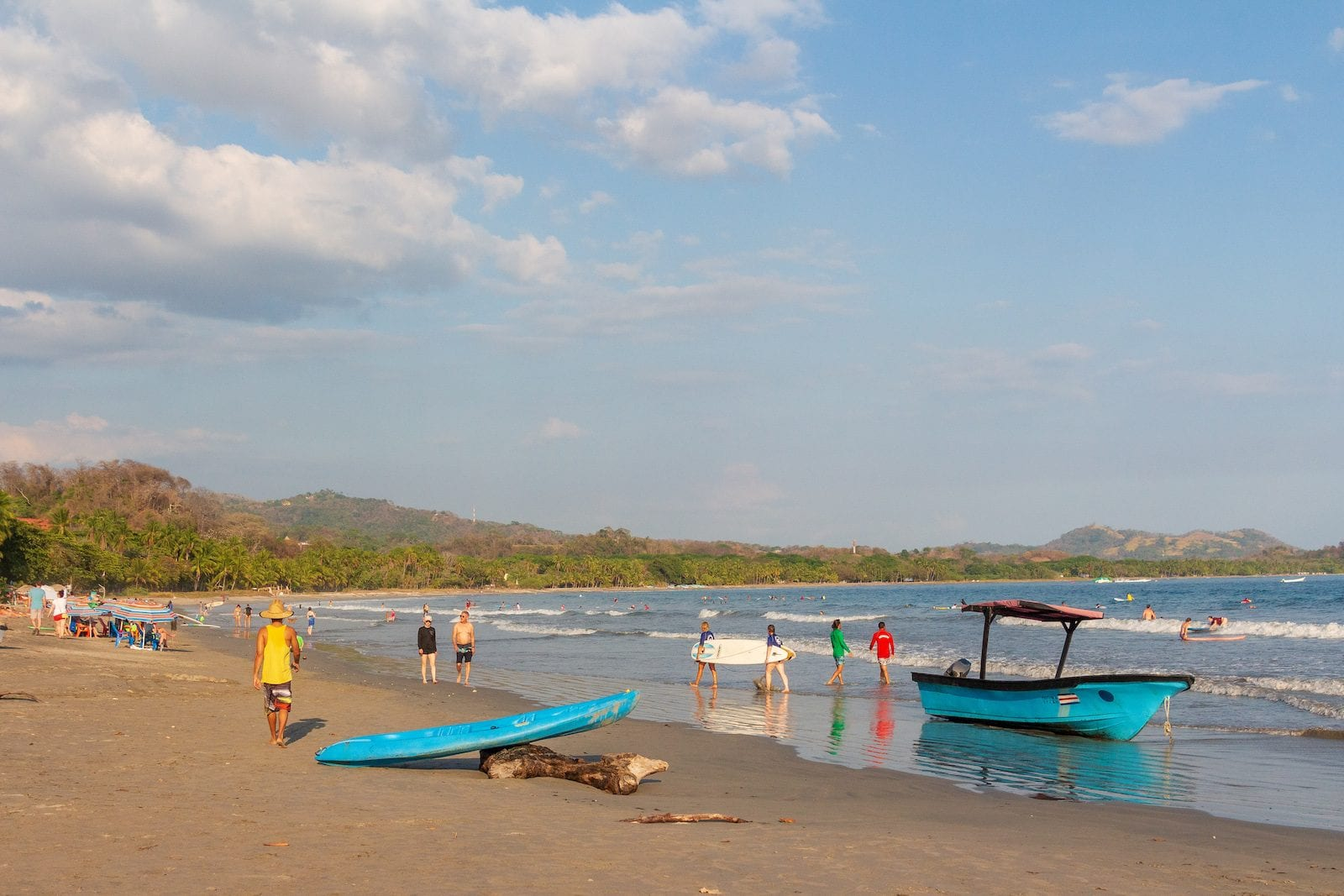 Section of Samara beach where boats launch and surfboarders surf, Costa Rica