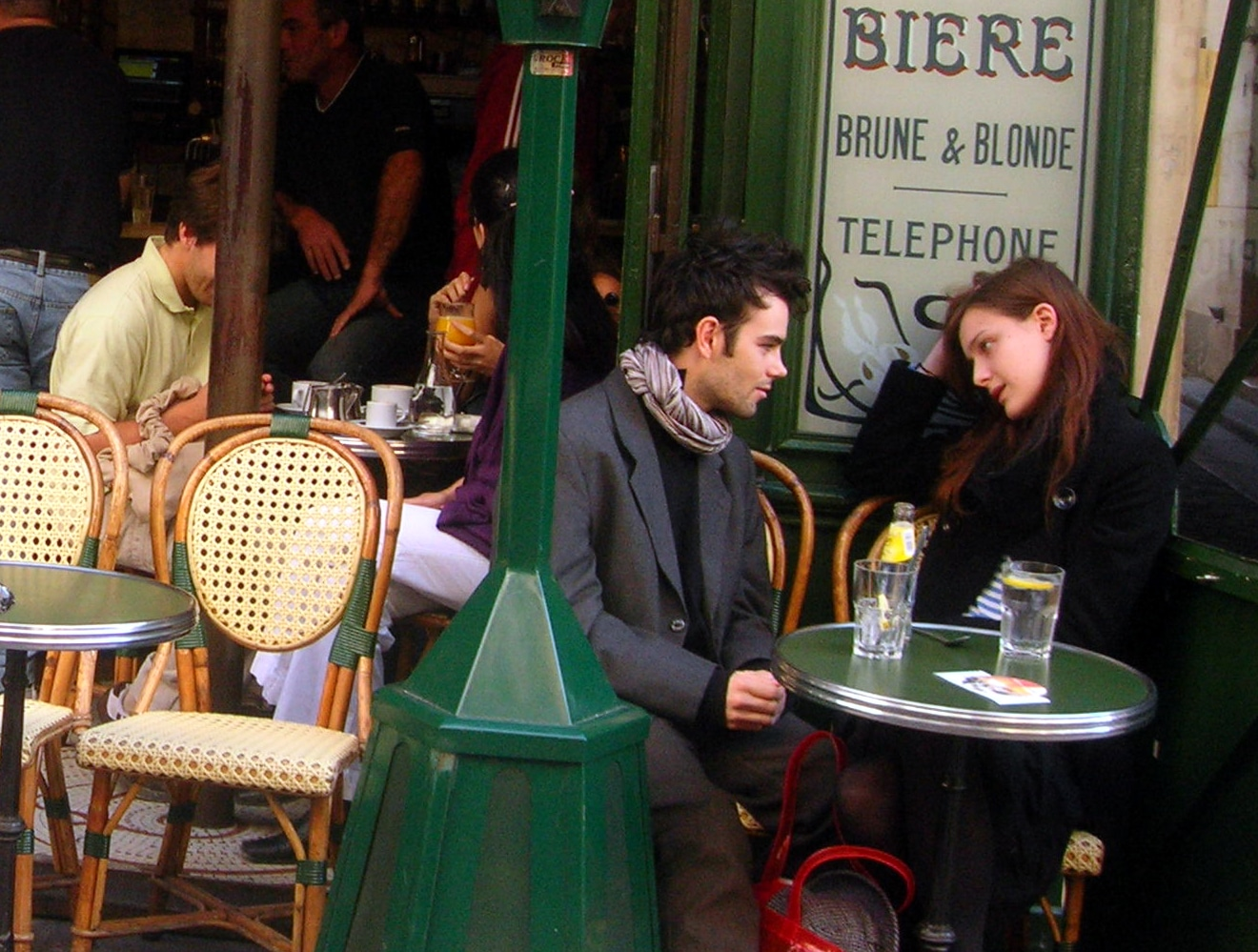 French Couple Speaking Language at Cafe