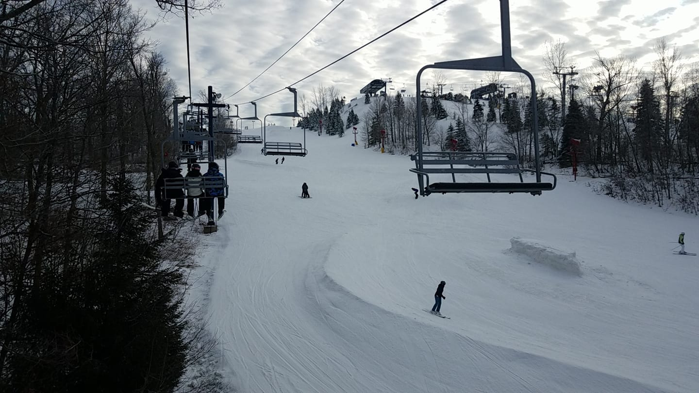 Image of people riding a ski lift at Alpine Valley Resort in Wisconsin