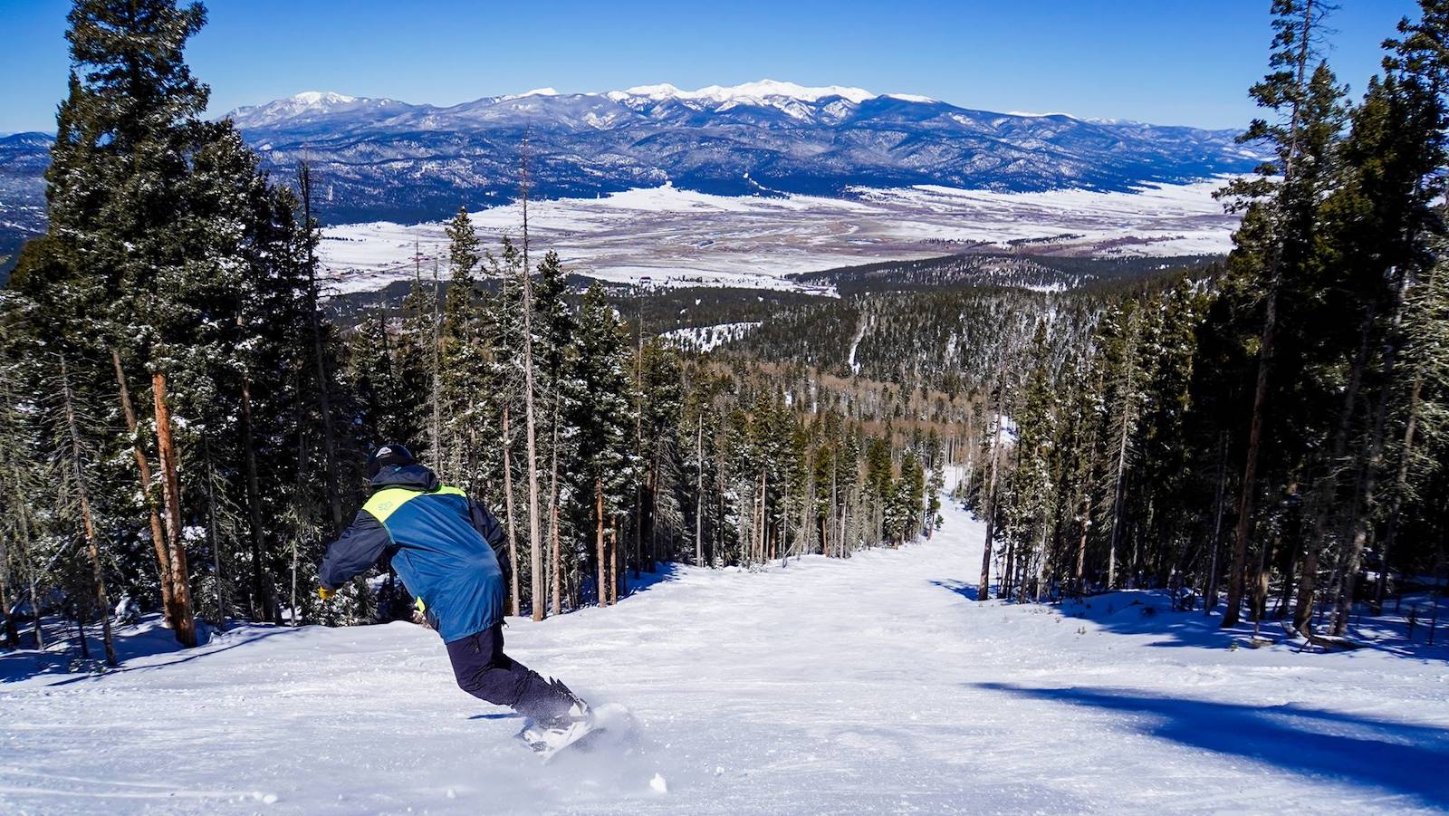 Image of a snowboarder hitting the slopes at Angel Fire Resort in New Mexico