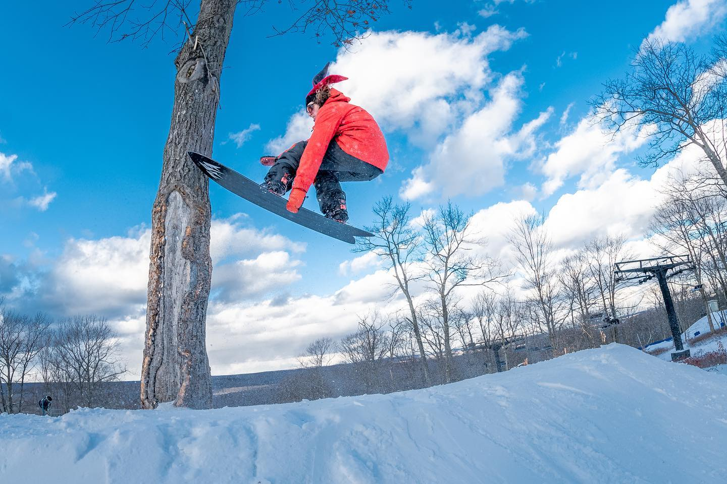 Image of a snowboarder in red catching air at Big Boulder Park in Pennsylvania