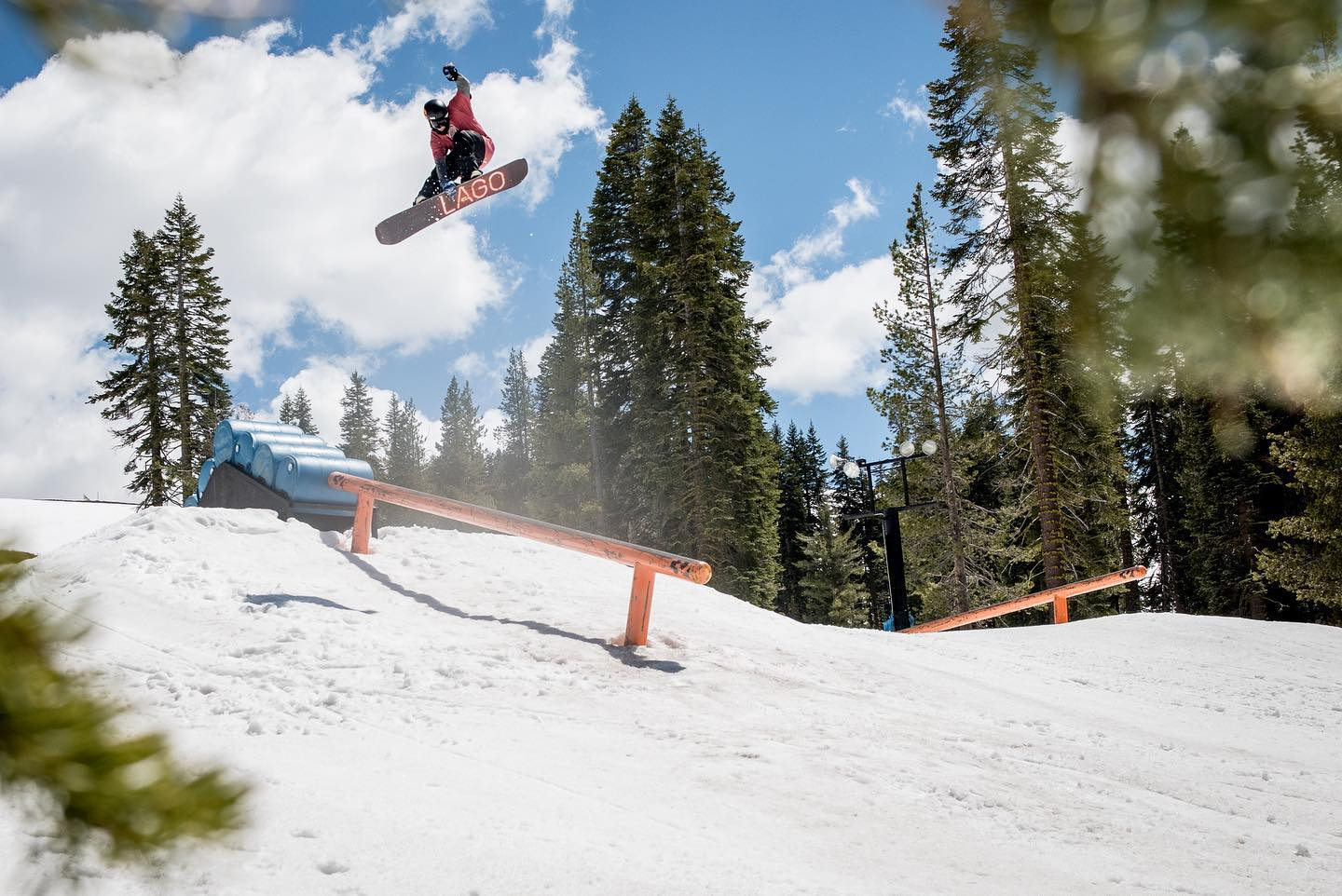 Image of a snowboarder catching air from a jump at the terrain park at Boreal Mountain Resort in California