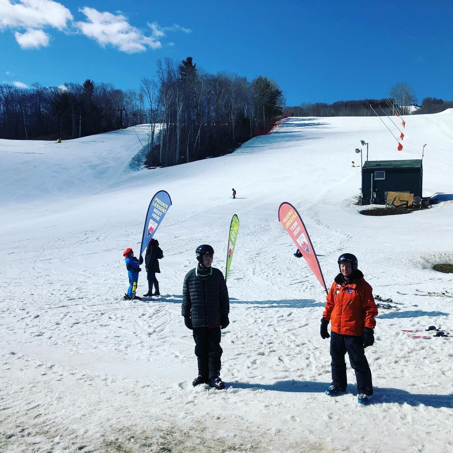 Image of visitors at the bottom of the slopes at Camden Snow Bowl Ski Resort in Maine