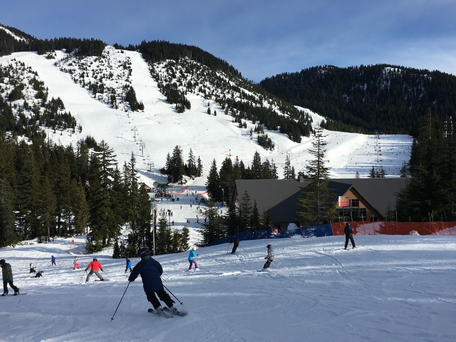 Image of skiers and snowboarders going down the slopes at Cypress Mountain in Canada
