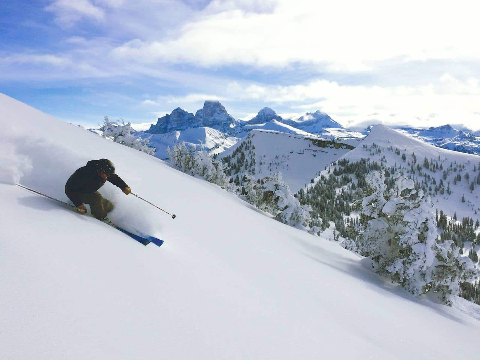 Image of a skier and stunning mountainous views at Grand Targhee Resort in Wyoming
