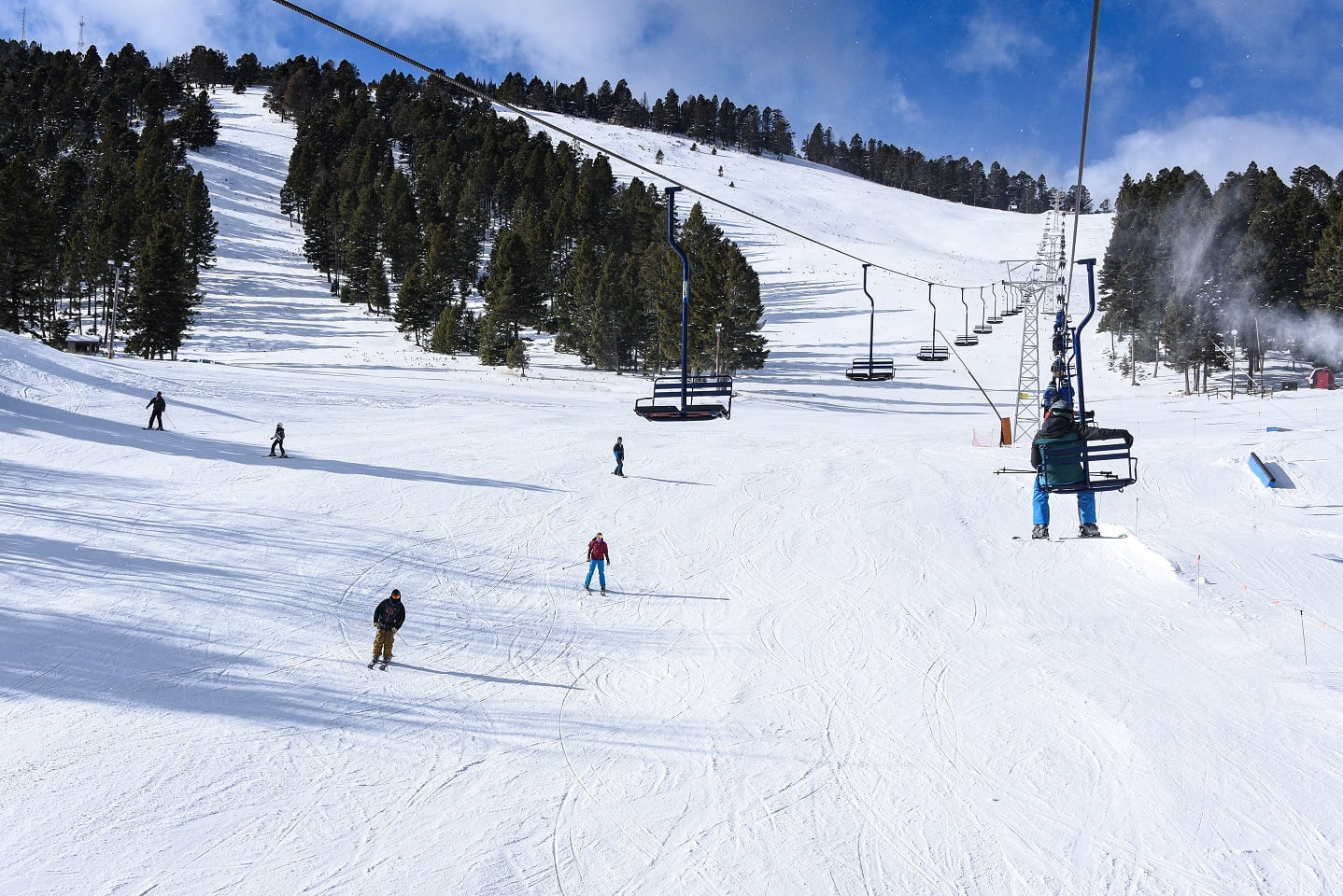 Image of a few skiers hitting the slopes at Great Divide Ski Area in Montana