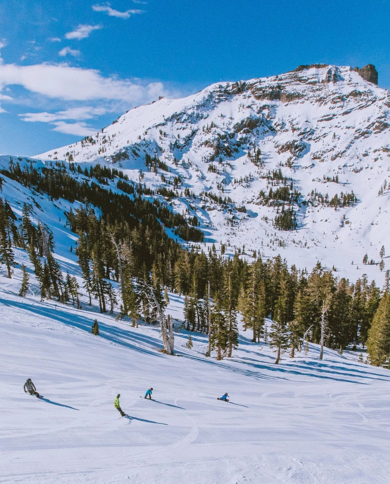 Image of skiers and snowboarders going down the slopes at Kirkwood Mountain Resort in South Lake Tahoe