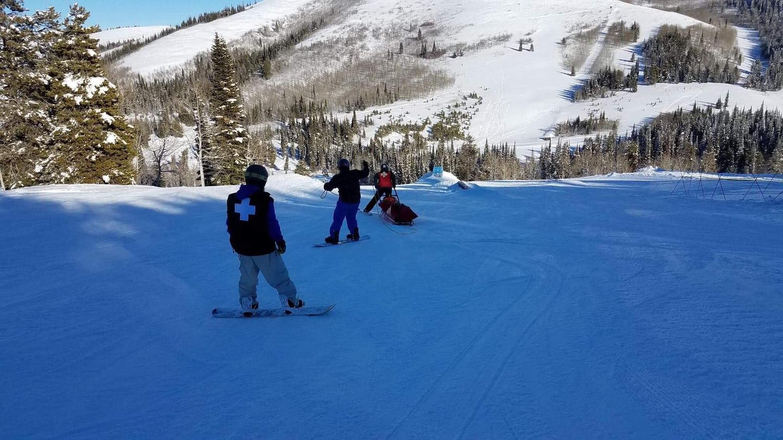 Image of ski patrol heading down the mountain at Magic Mountain Ski Resort in Idaho
