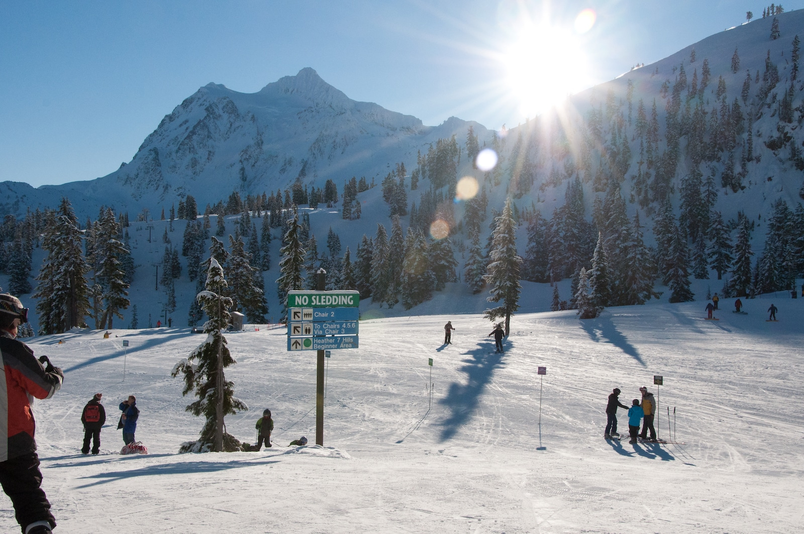 Image of sunny skies and snow covered mountains at Mount Baker Ski Area in Washington