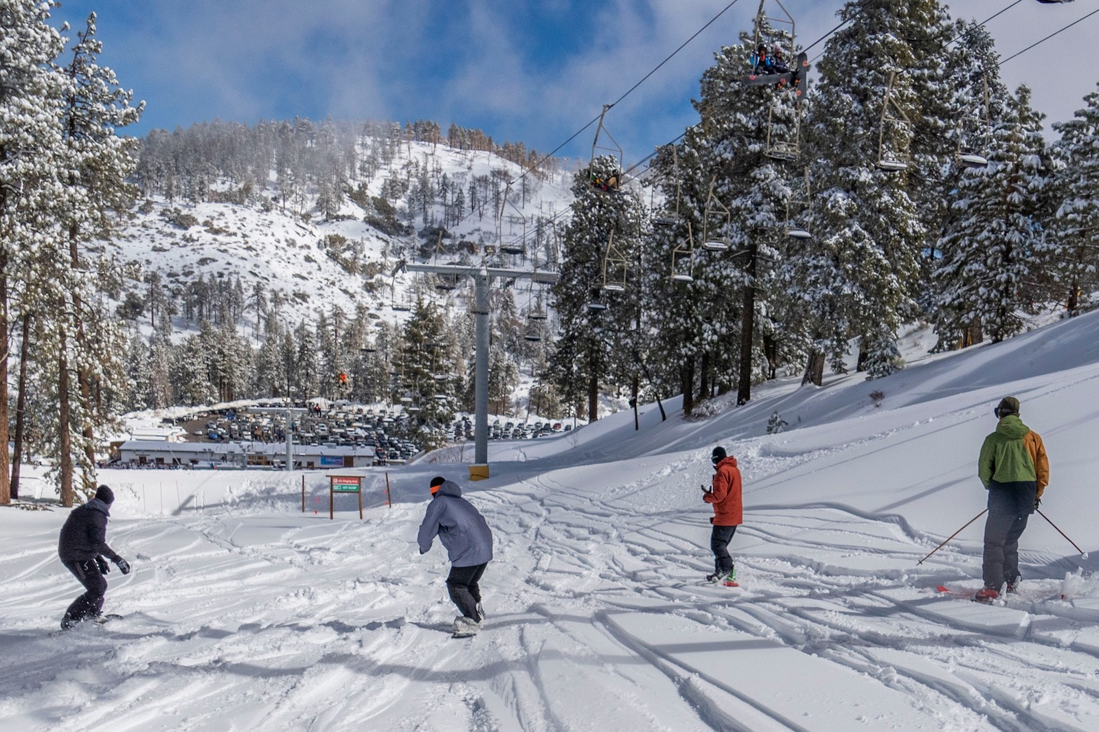 Image of two snowboarders and two skiers at Mountain High Resort in California