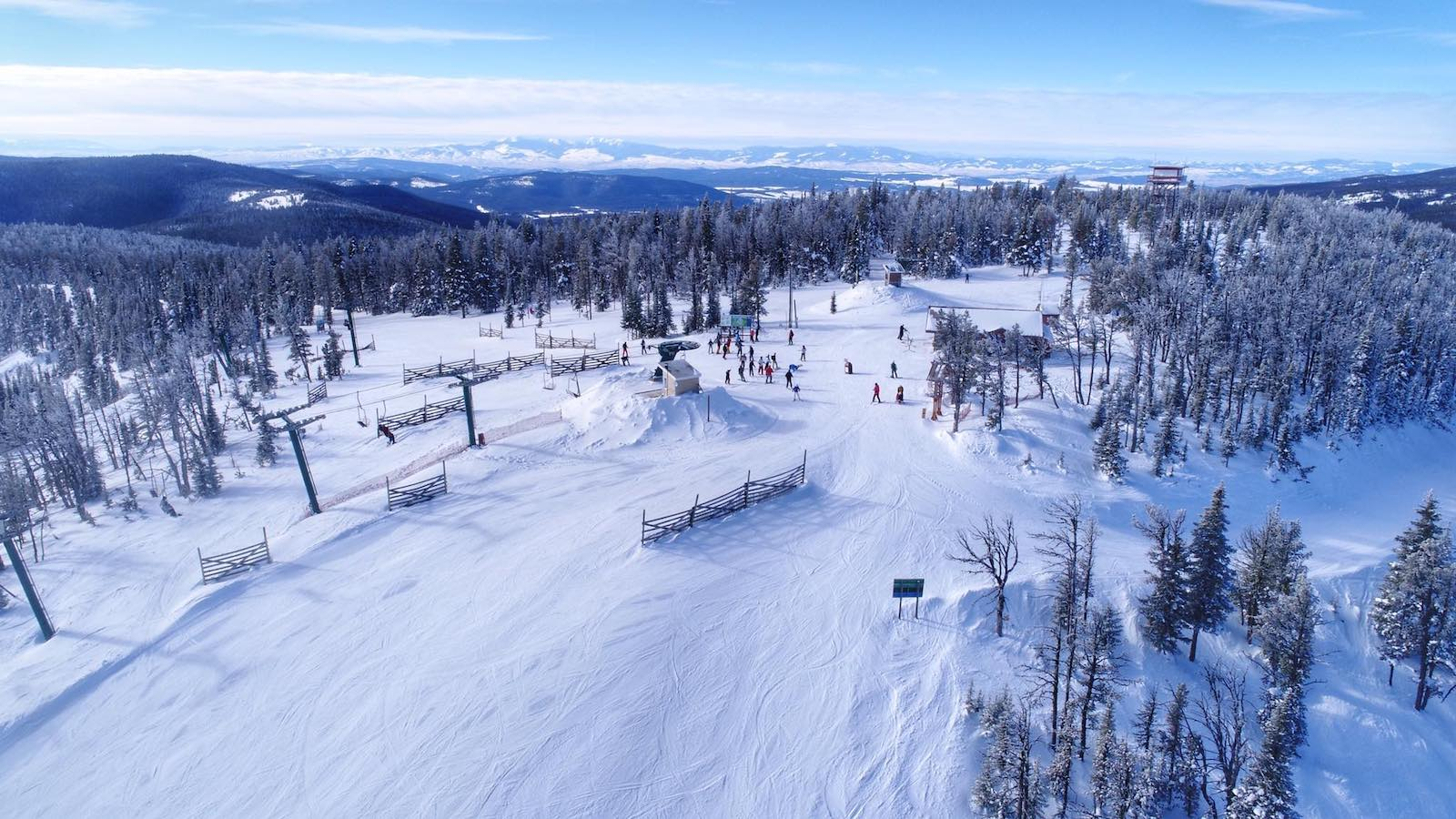 Image of skiers on mostly empty slopes at Showdown Montana