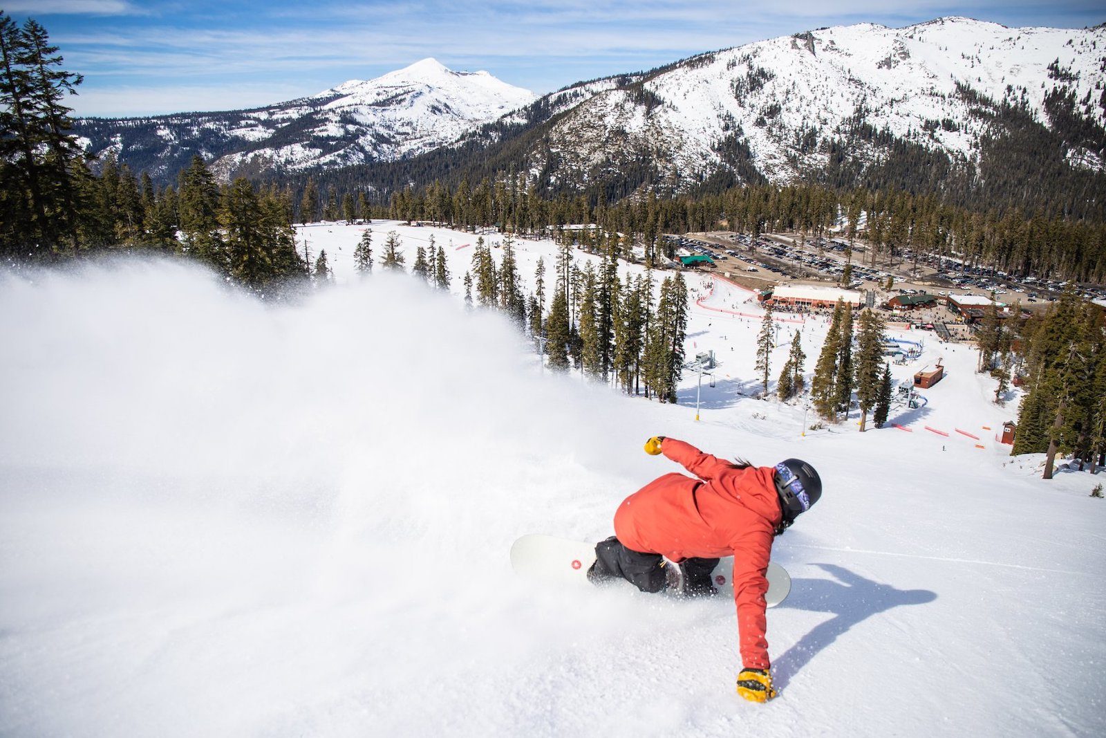 Image of a snowboarder in red going down the slopes at Sierra-at-Tahoe Resort in California