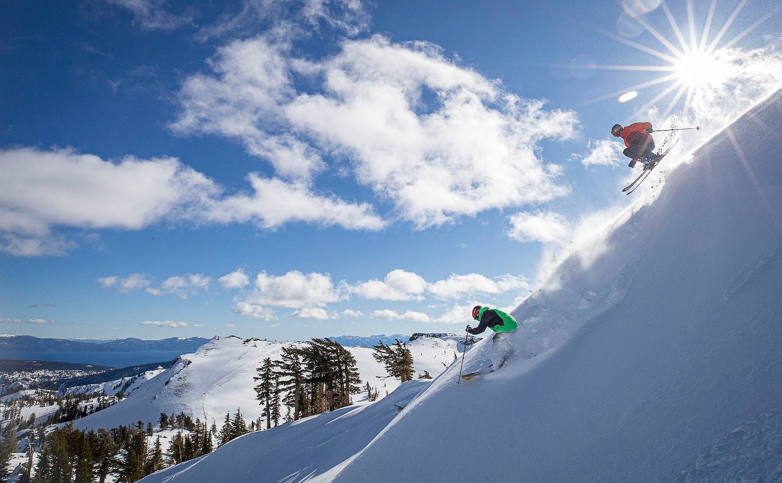 Two skiers hitting the slopes at Squaw Alpine Resort in California