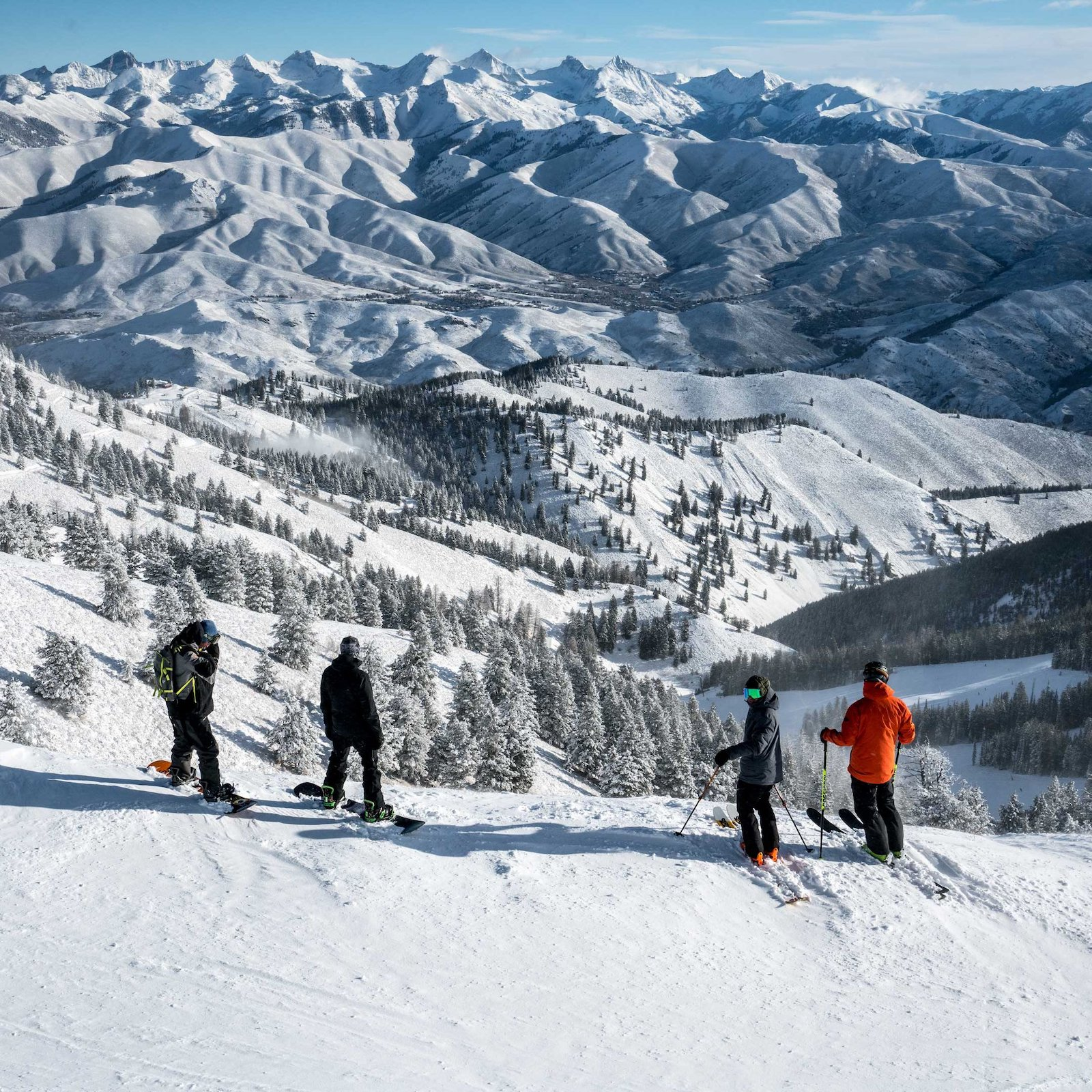 Image of snowboarders and skiers looking out at mountains at Sun Valley Ski Resort in Idaho