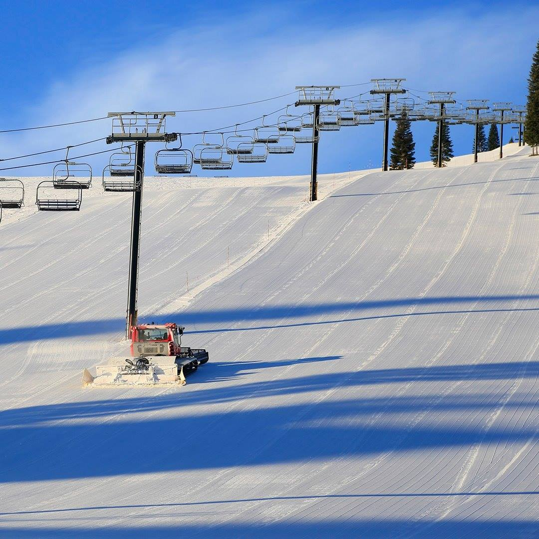 Image of empty slopes being serviced at Tahoe Donner Downhill Ski Resort in California