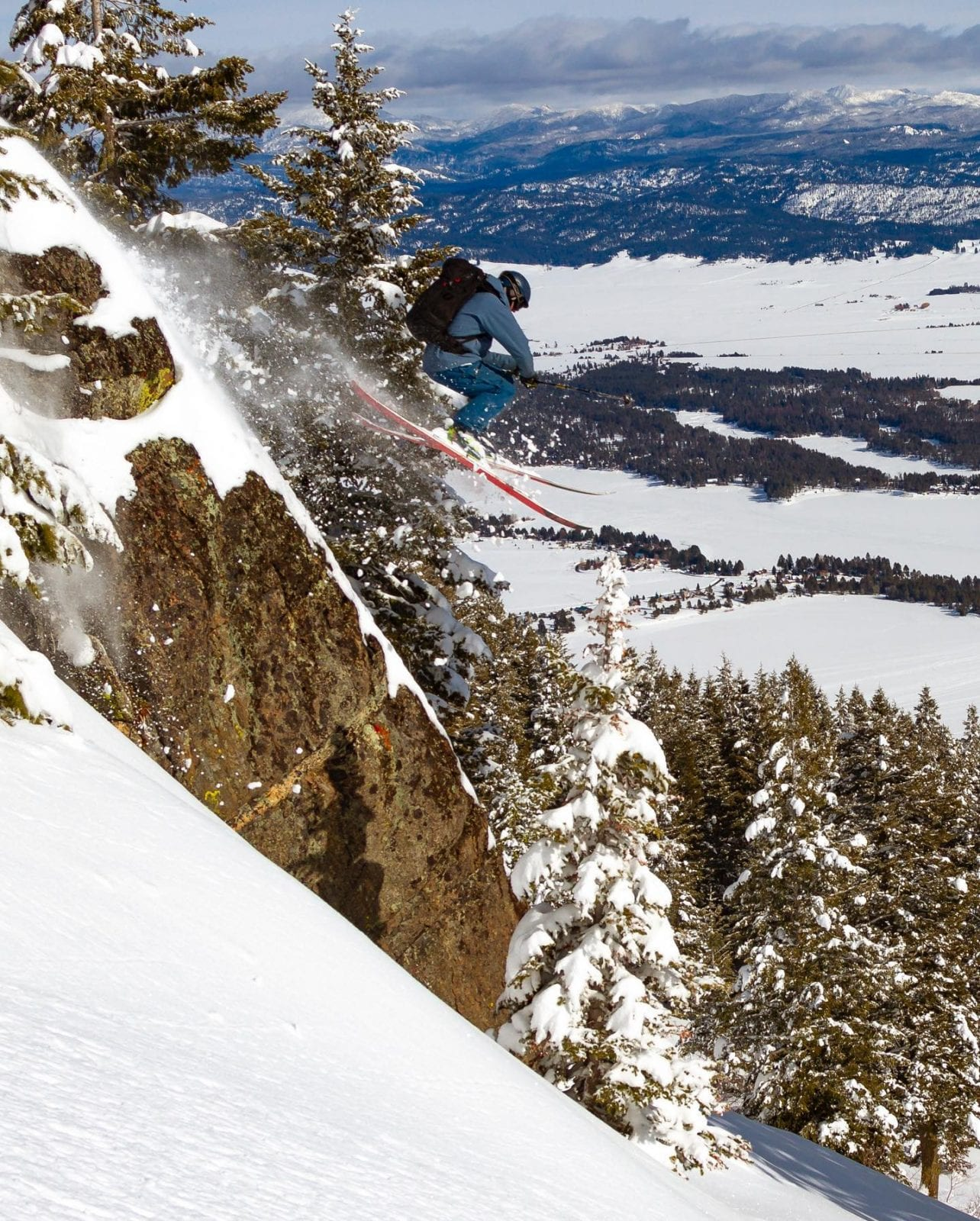 Image of a skier jumping off a cliff at Tamarack Resort in Idaho