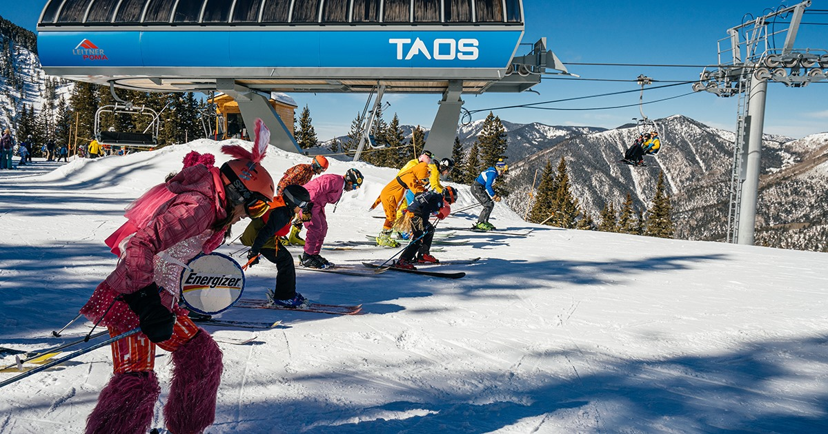 Image of skiers at the top of the slopes at Taos in New Mexico