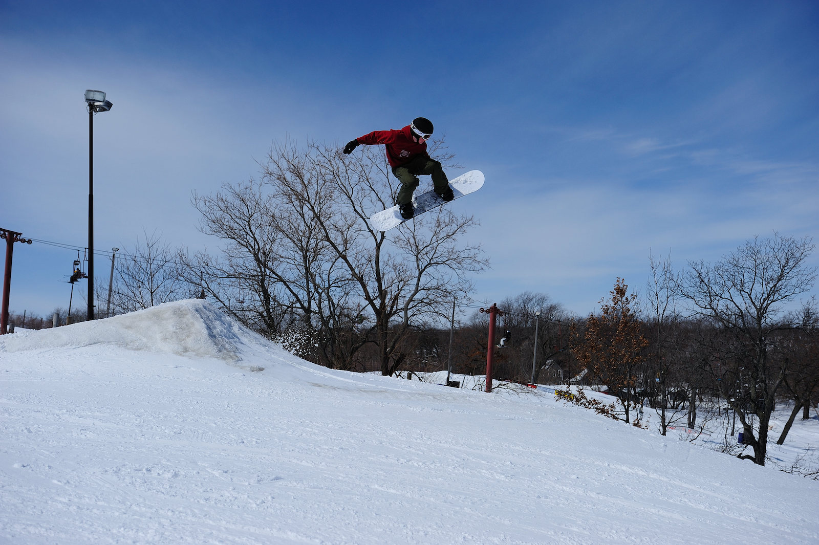 Image of a snowboarder flying through the air at Wilmot Mountain Ski Resort in Wisconsin
