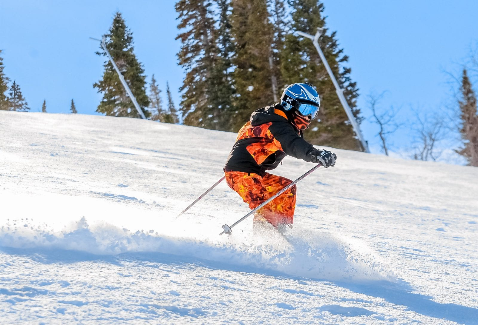 Image of a skier hitting the slopes in Utah
