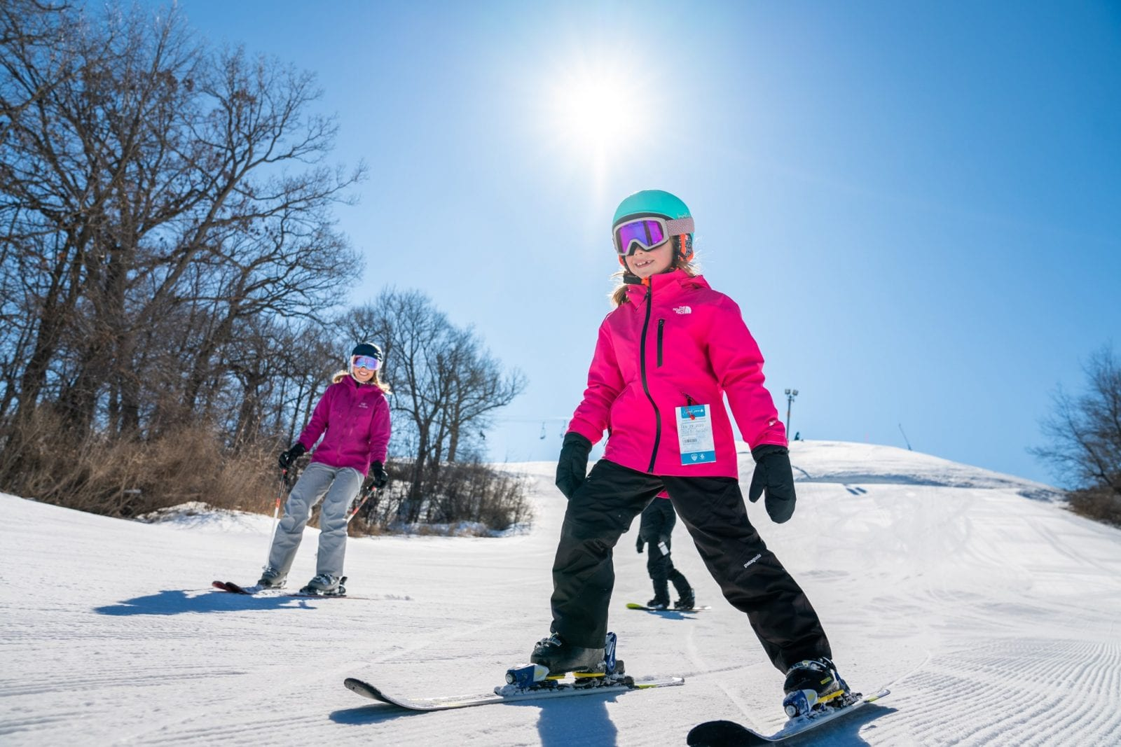 Image of a parent and child skiing at Mountain Top Ski & Adventure Center in Wisconsin