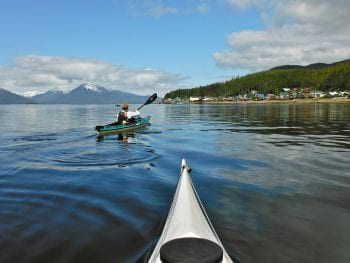 Image of kayakers on the water at Tenakee Springs, Alaska