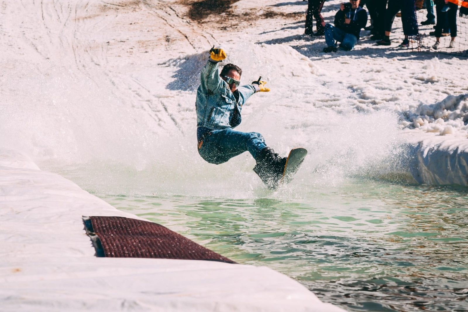 Image of a snowboarder pond skimming at Red River Ski & Summer Area