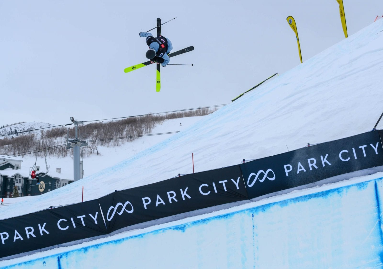Image of a skier getting big air at a ski competition at Park City Mountain in Utah