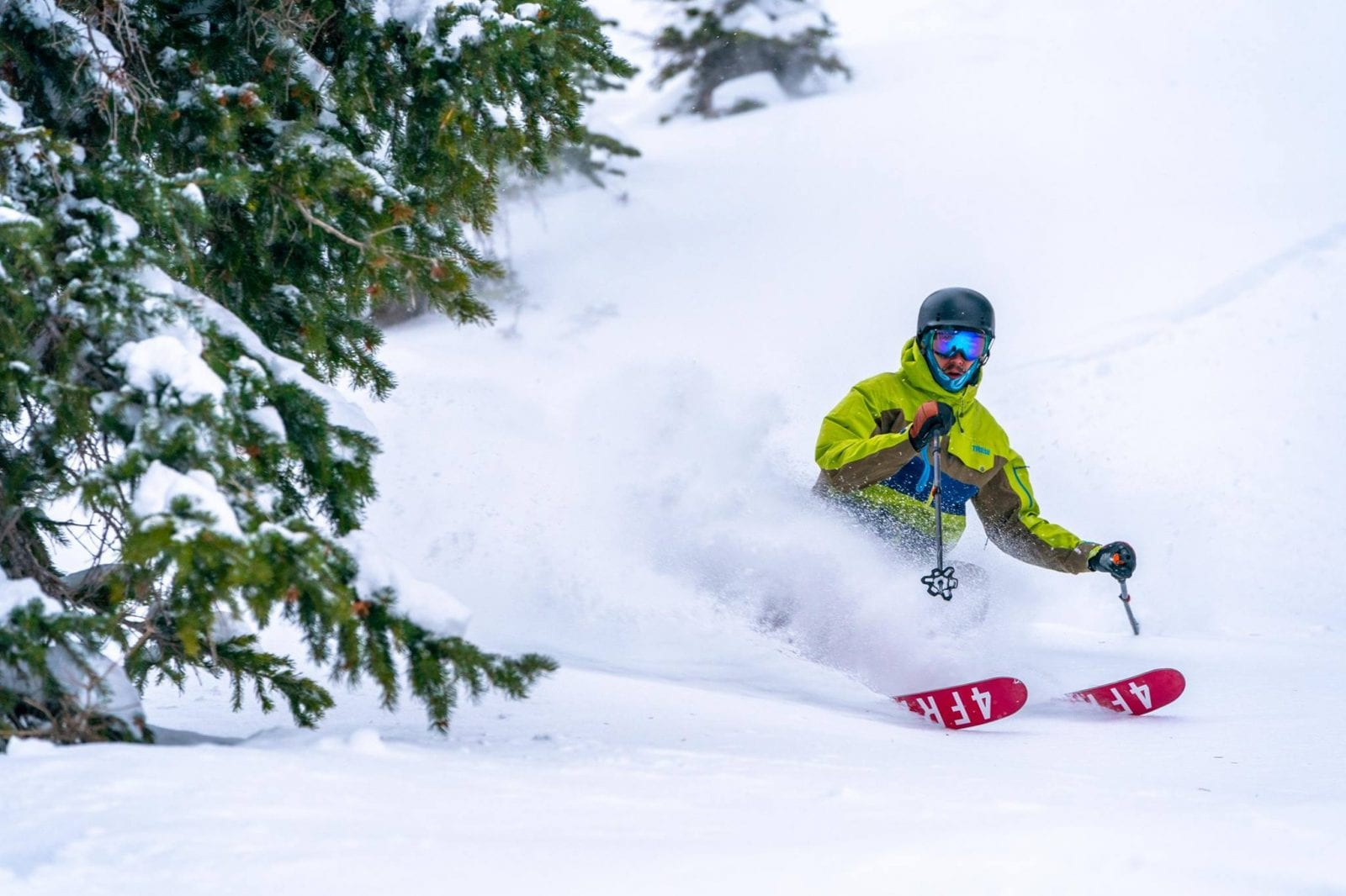 Image of a skier in neon going down the slopes at Solitude Mountain in Utah