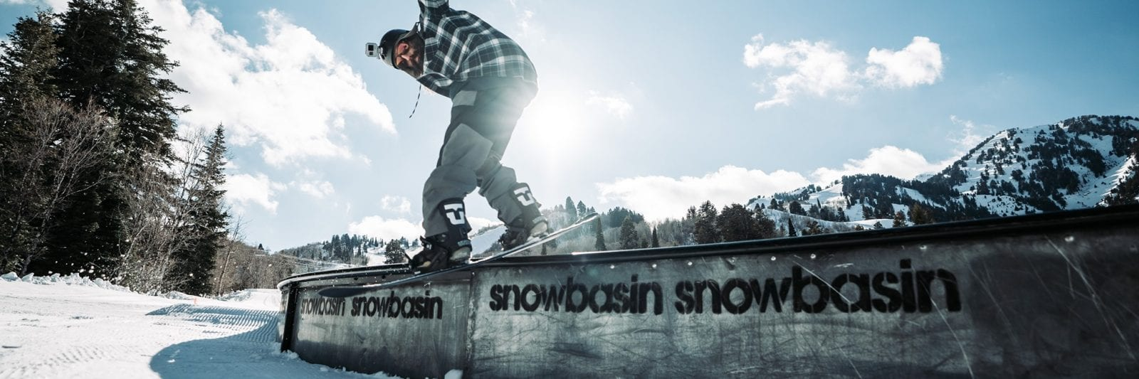 Image of a snowboarder grinding a rail at Snowbasin in Utah