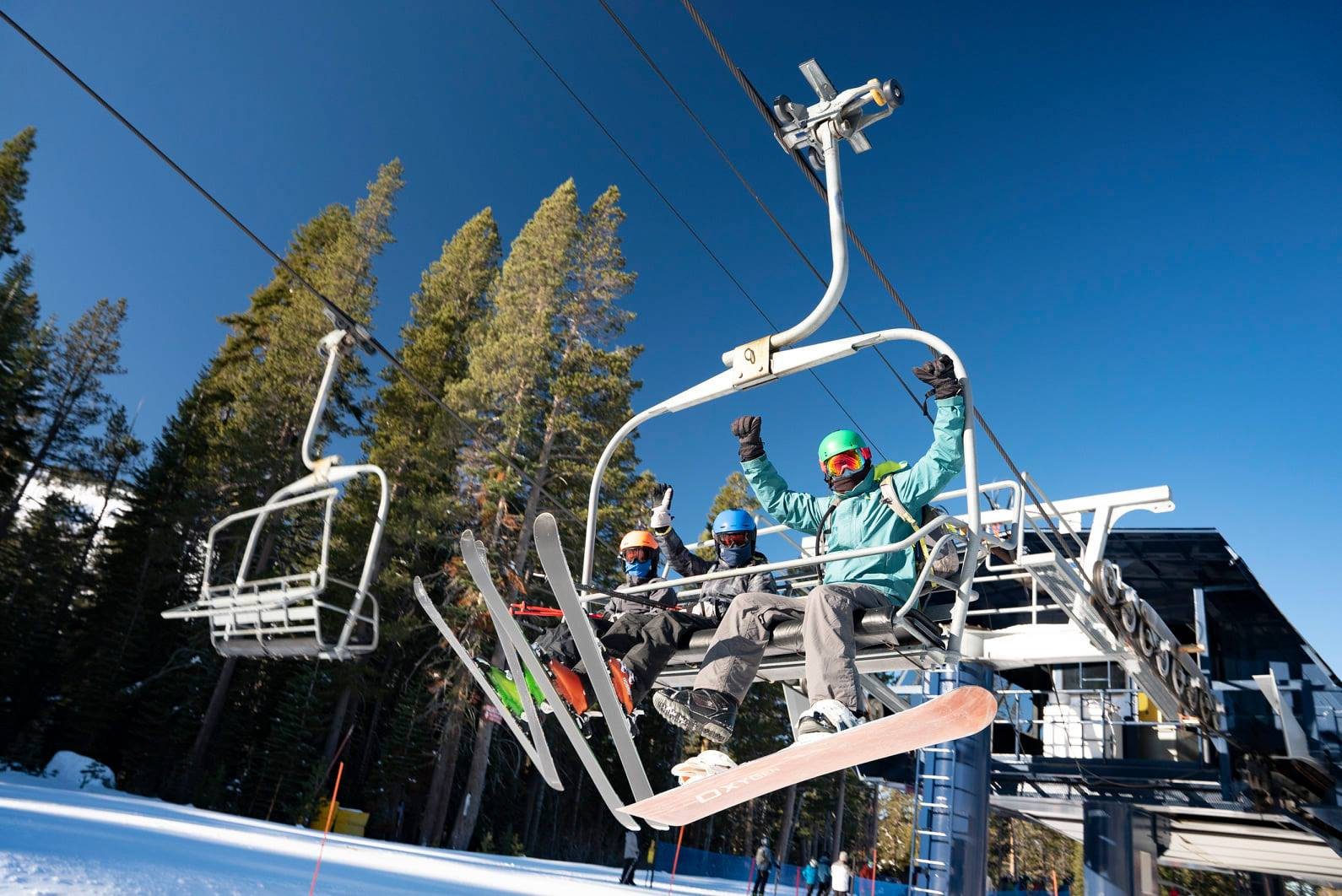 Image of skier and snowboarder on the chairlift at Sugar Bowl Resort