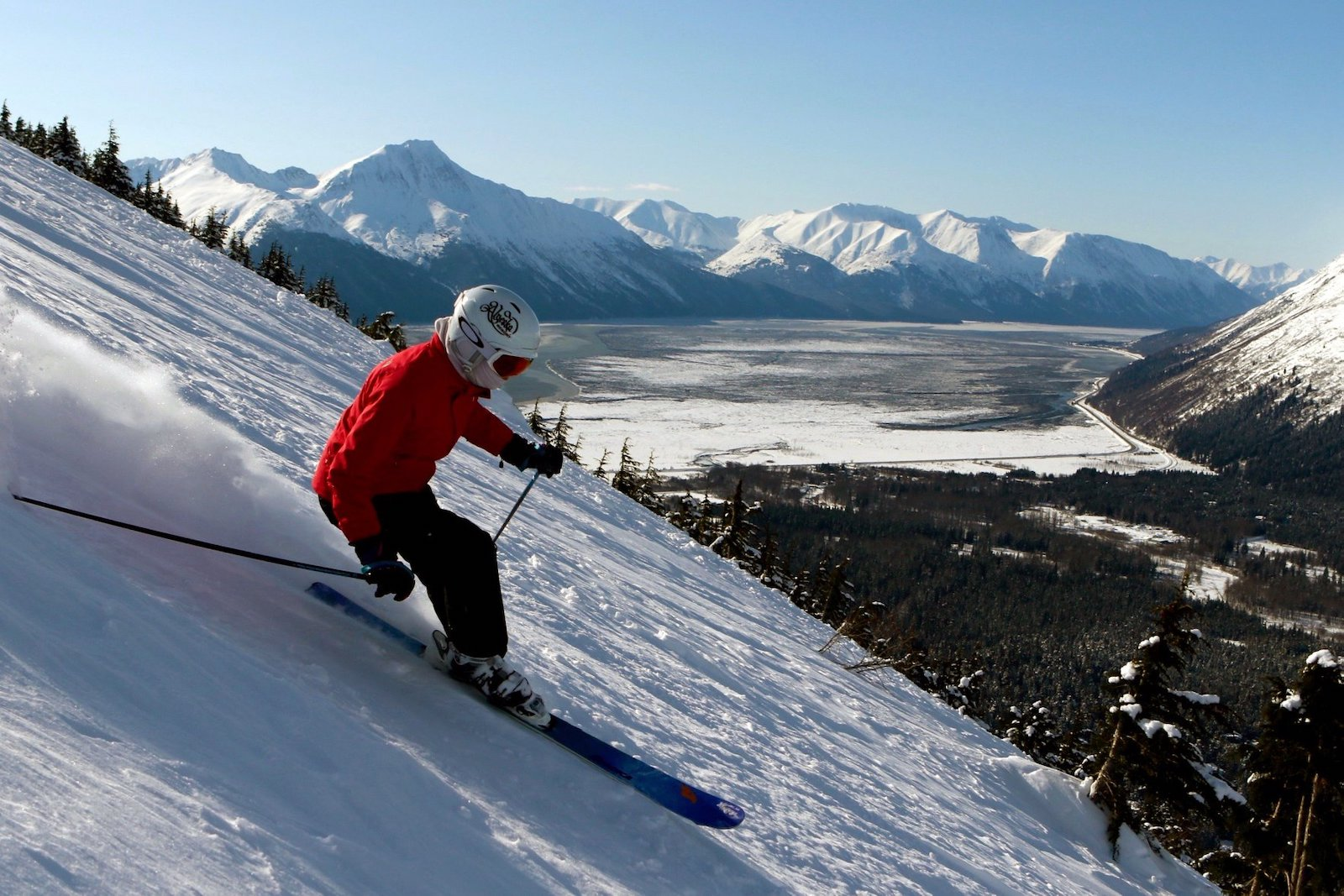 Image of a skier in red hitting the slopes at Alyeska Resort in Alaska