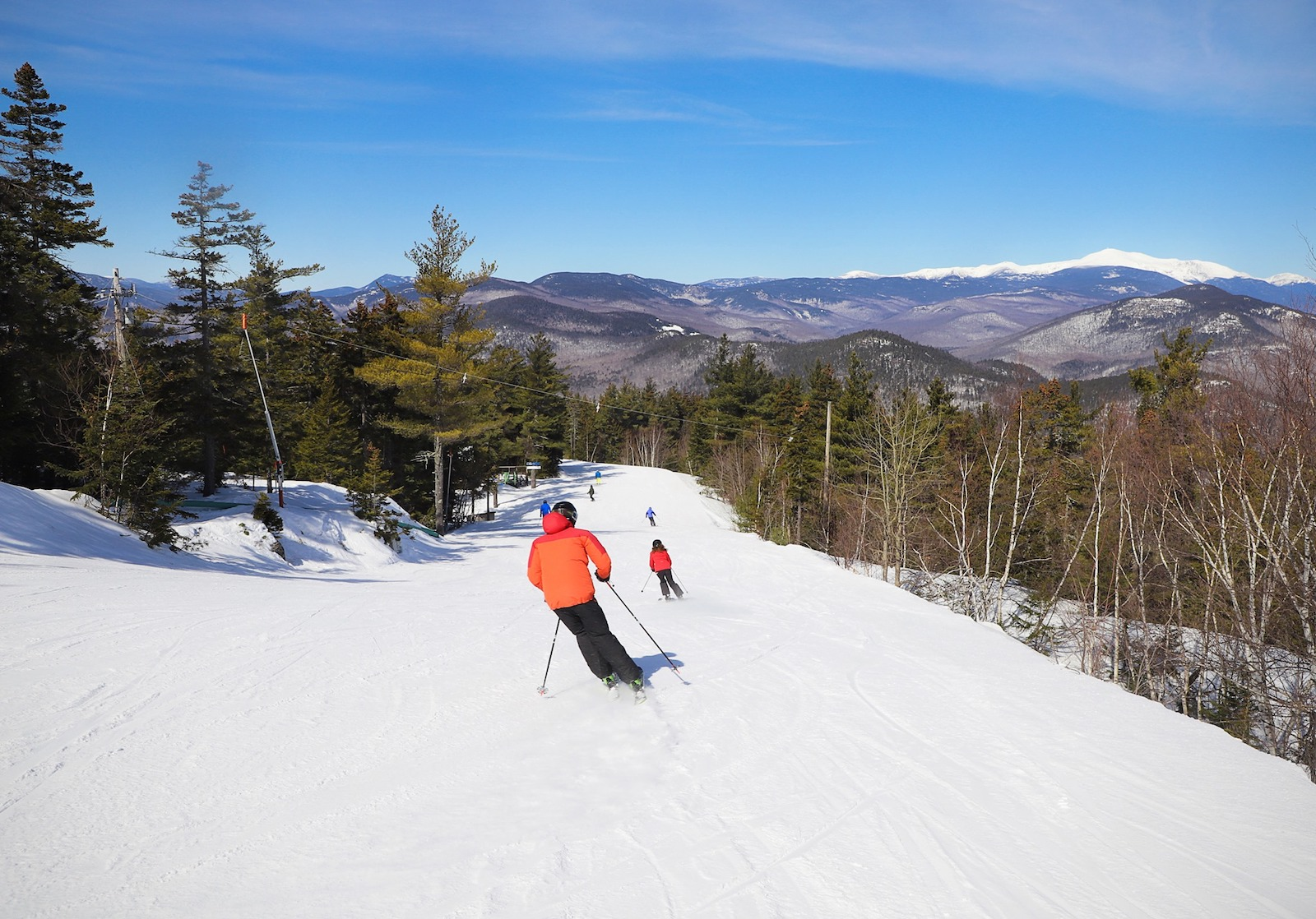 Image of skiers on the slopes at Attitash Mountain Resort in New Hampshire