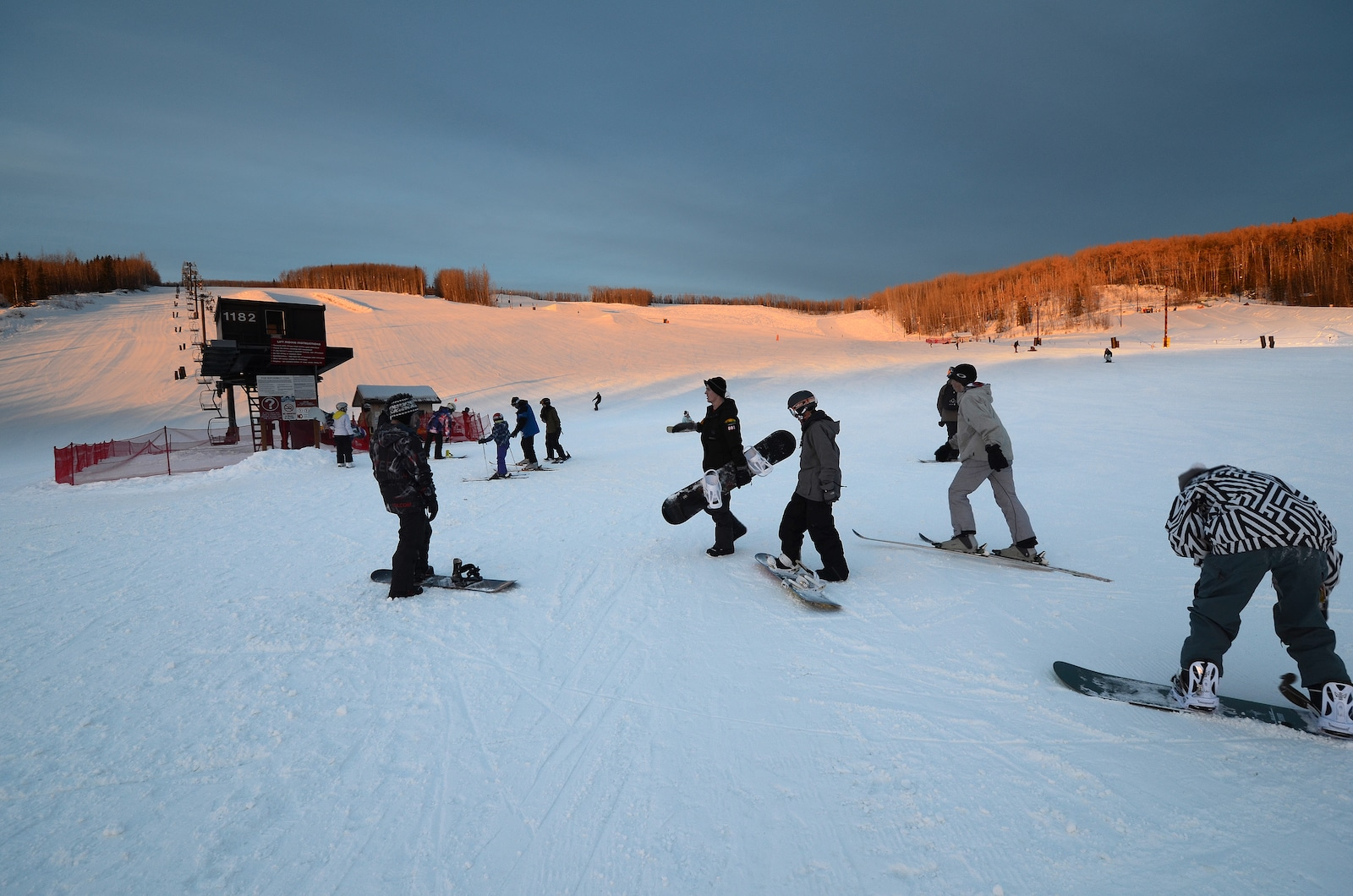 Image of snowboarders at sundown at Birch Hill Ski and Snowboard Area in Alaska