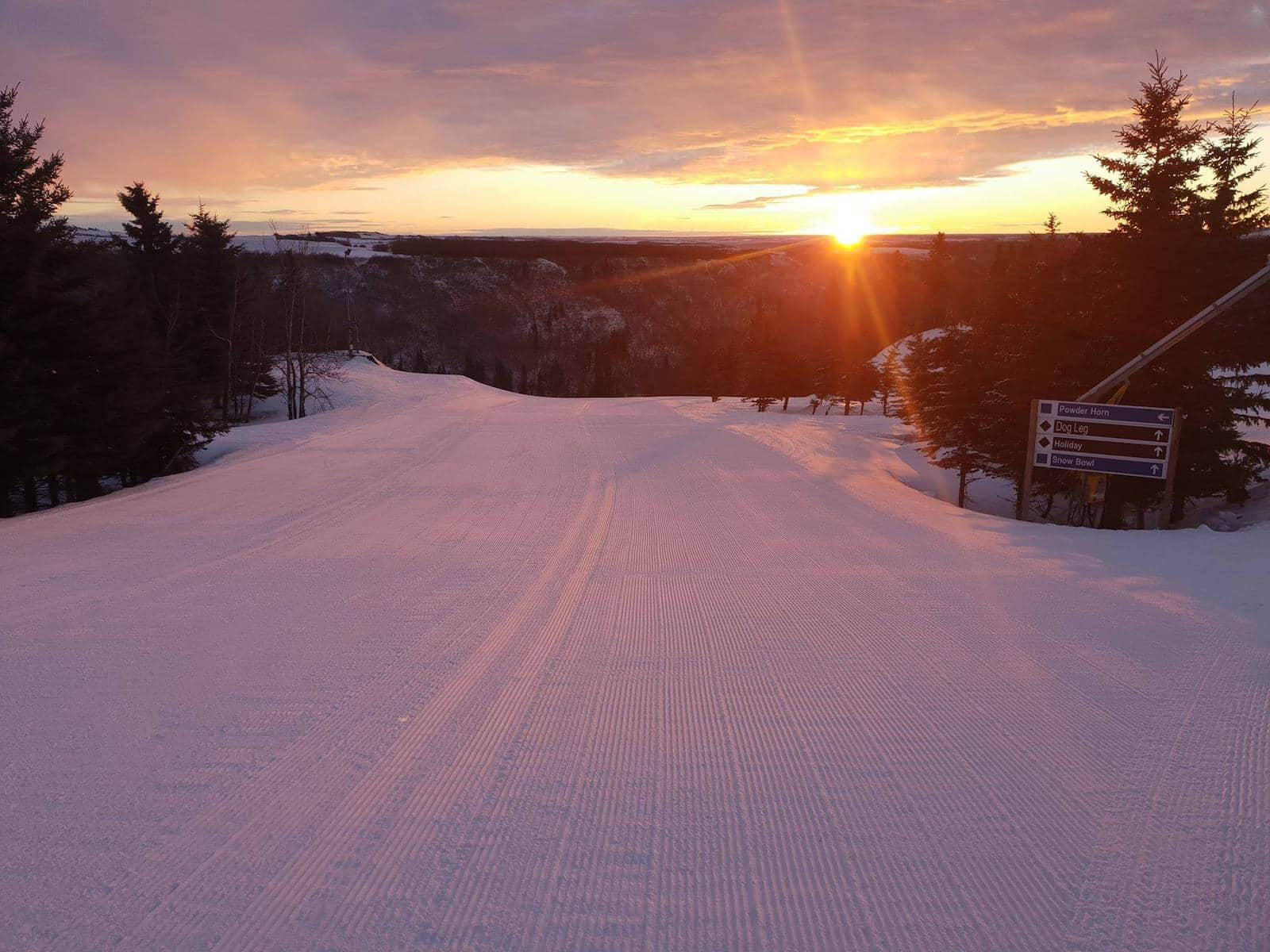 Image of the sun setting over Canyon Ski Resort & Recreation Area in Canada