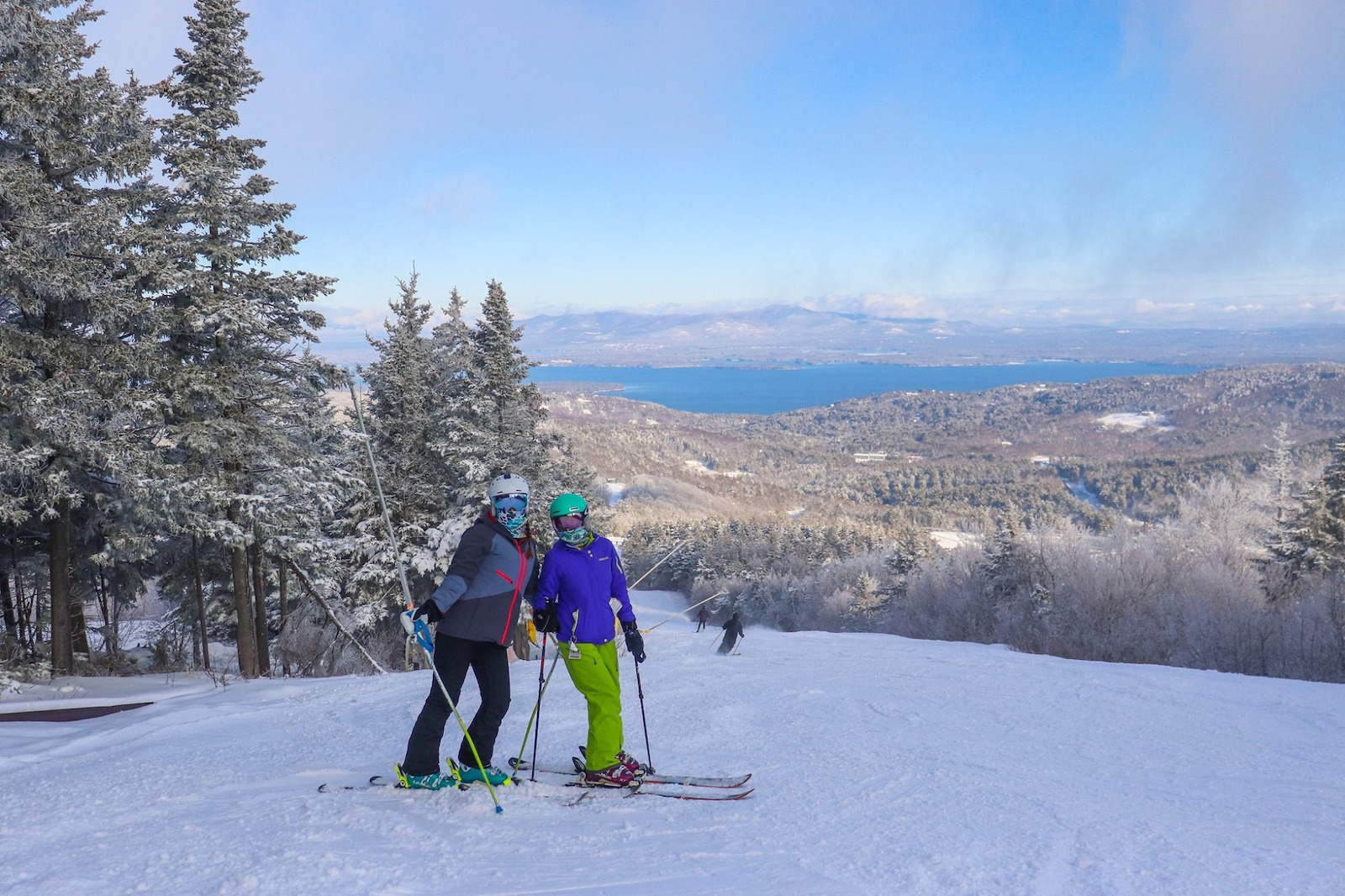 Image of two skiers at the top of the summit at Gunstock Mountain Resort in New Hampshire