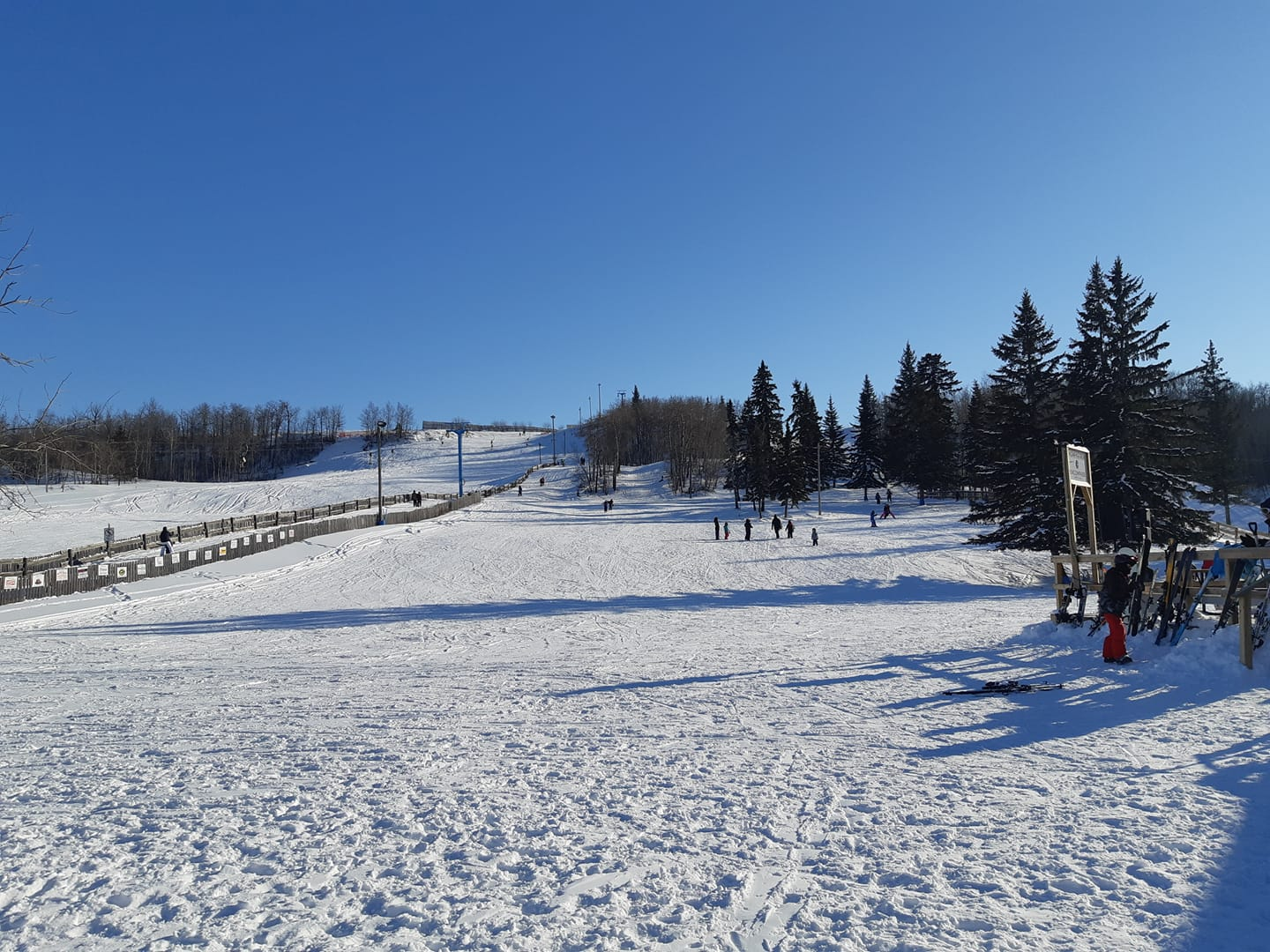 Image of Gwynne Valley Ski Area in Canada from the bottom of the slopes on a bluebird day