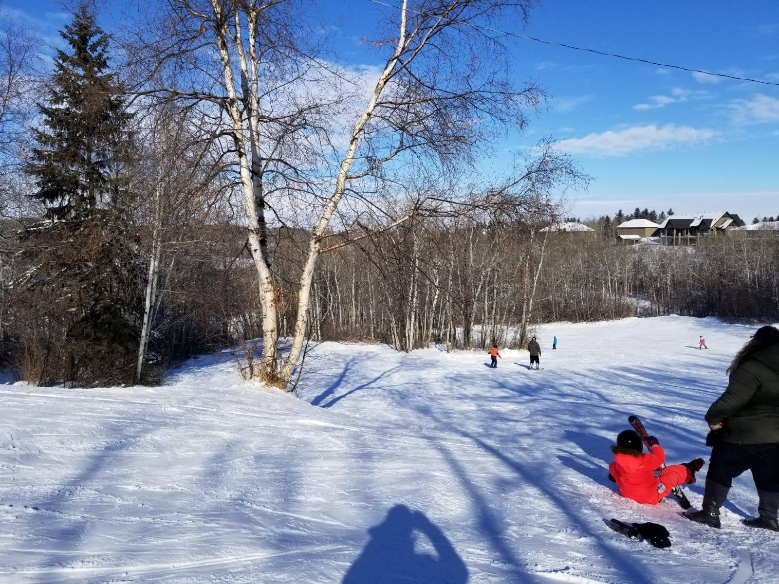 Image of skiers at Innisfail Ski Hill in Canada