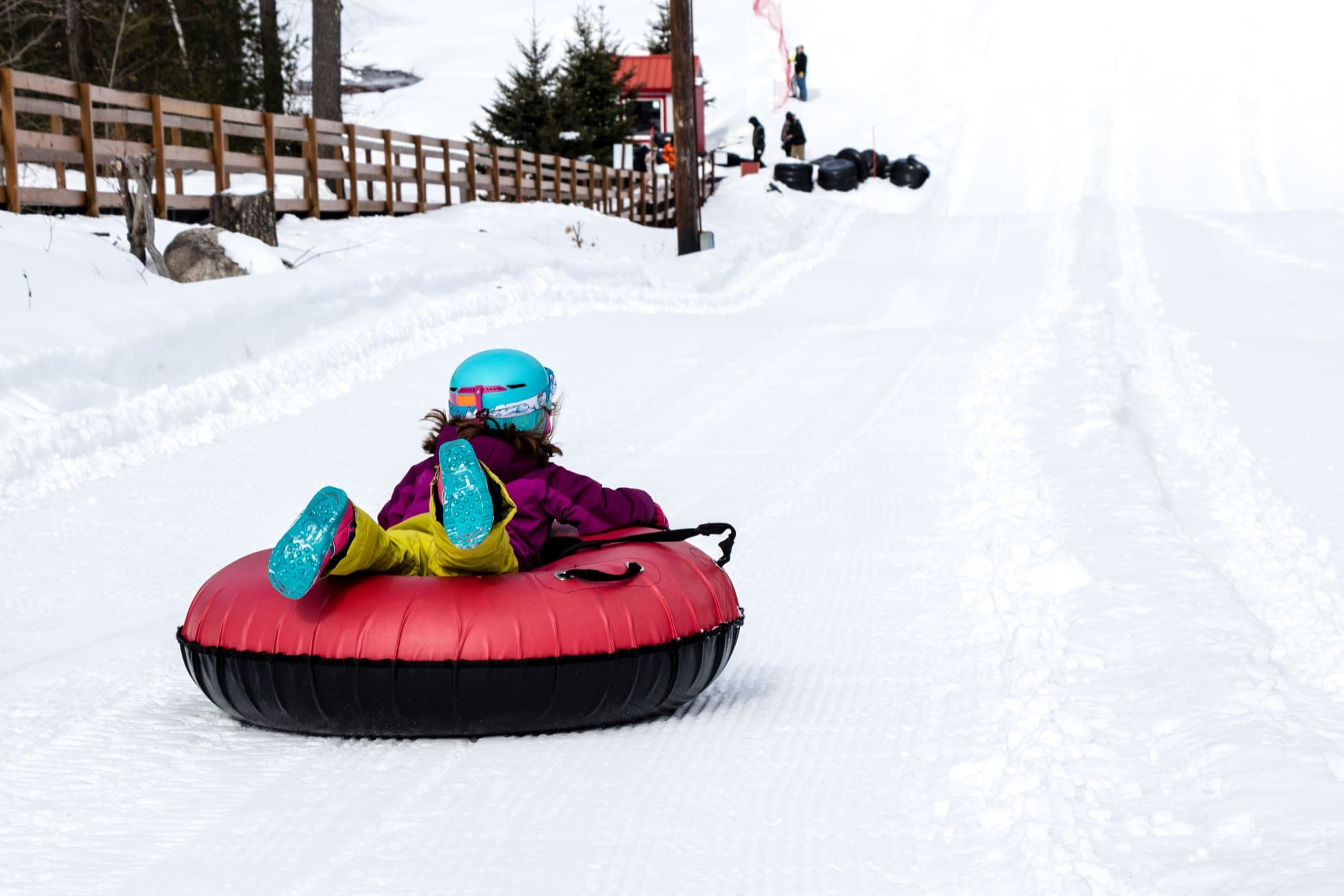 Image of a child tubing at McIntyre Ski Area in New Hampshire