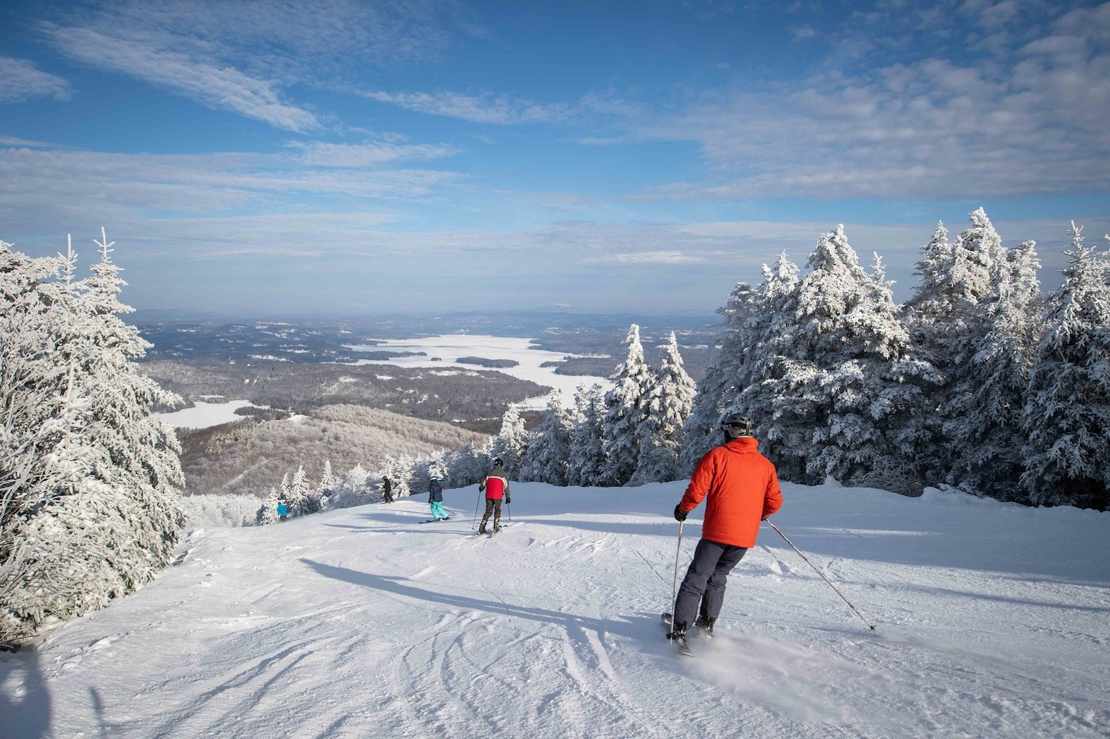 Image of multiple skiers going down the slopes at Mount Sunapee Resort in New Hampshire