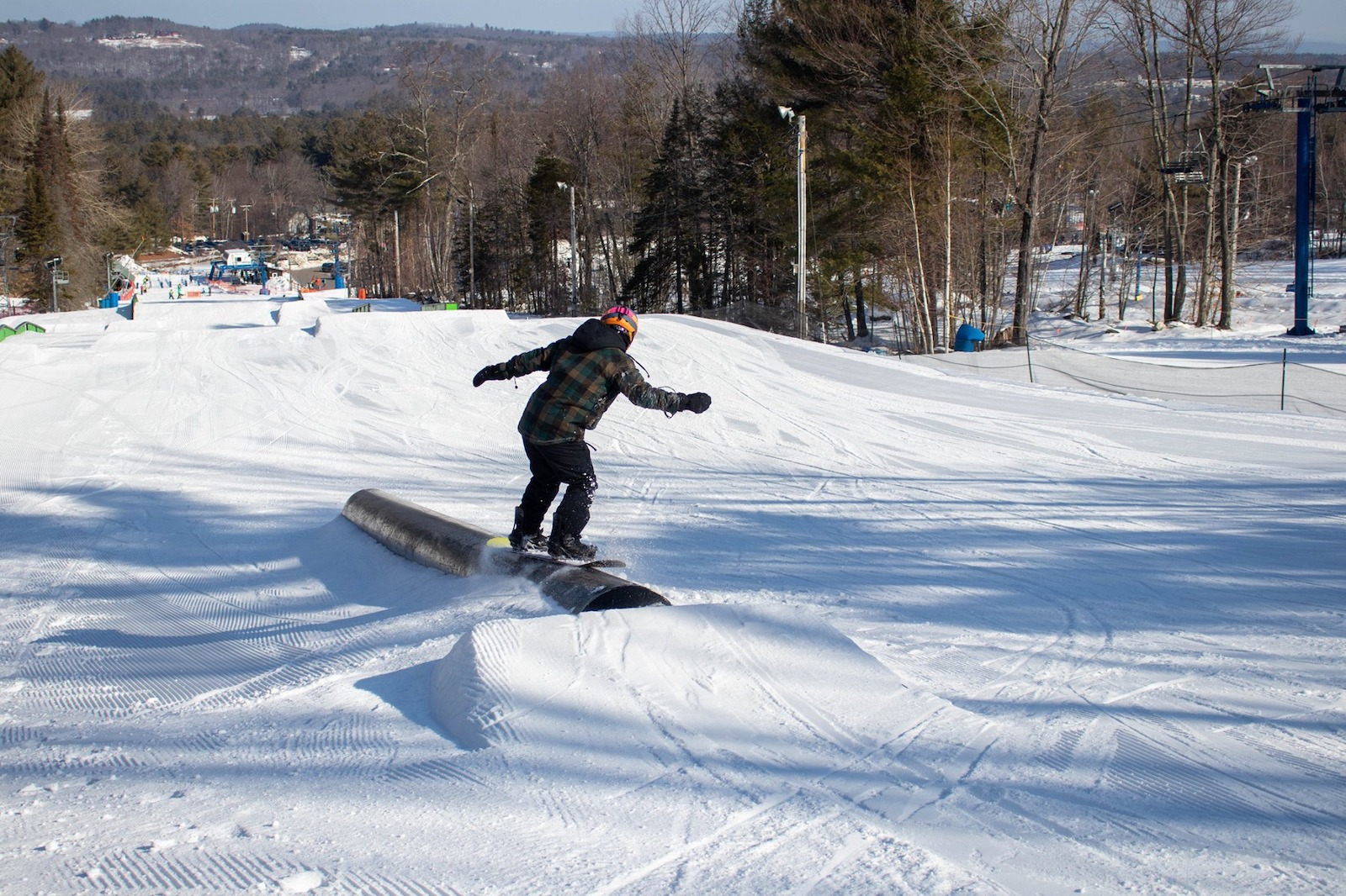 Image of as snowboarder grinding a rail at Pats Peak Ski Area in New Hampshire