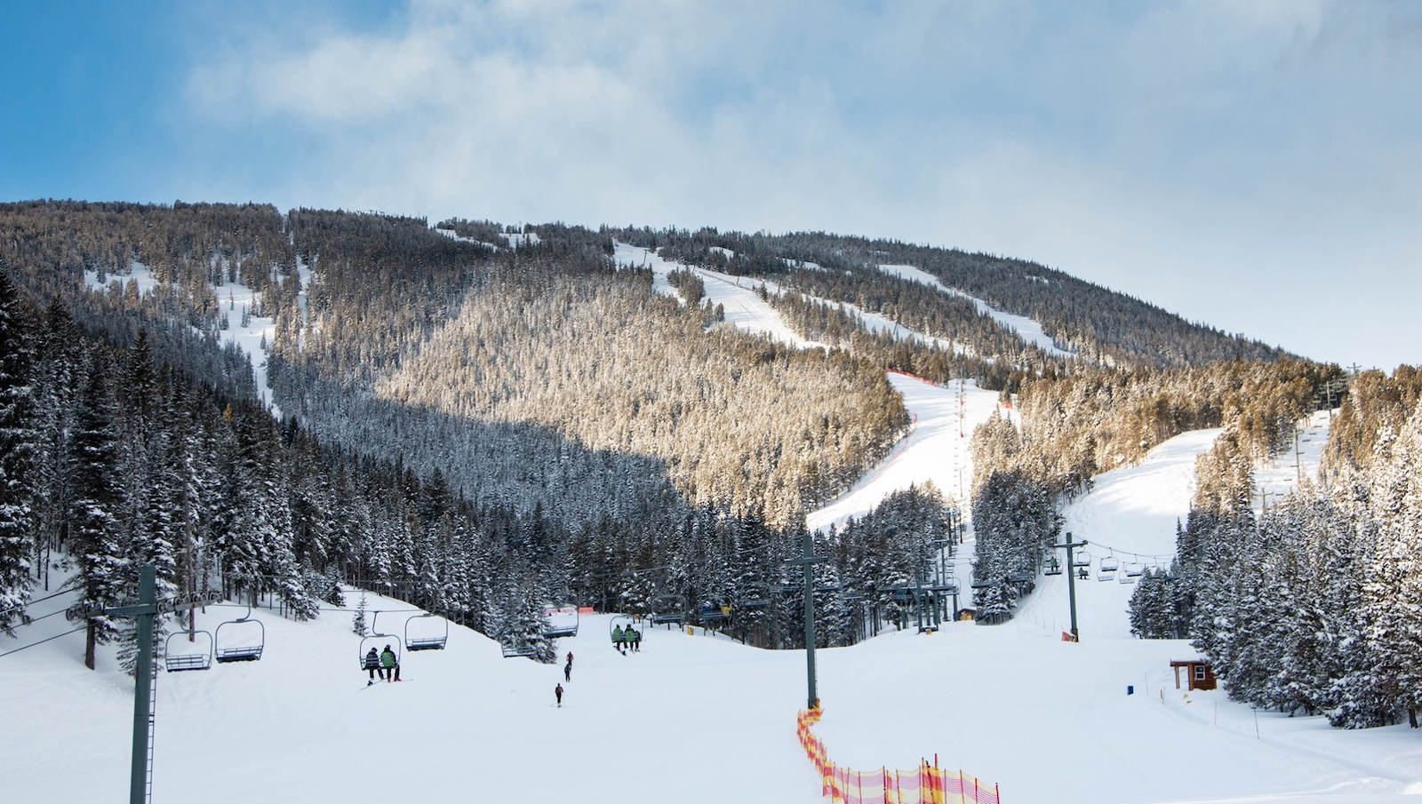 Image of skiers and snowboarders on the chairlift at Red Lodge Mountain, Wyoming