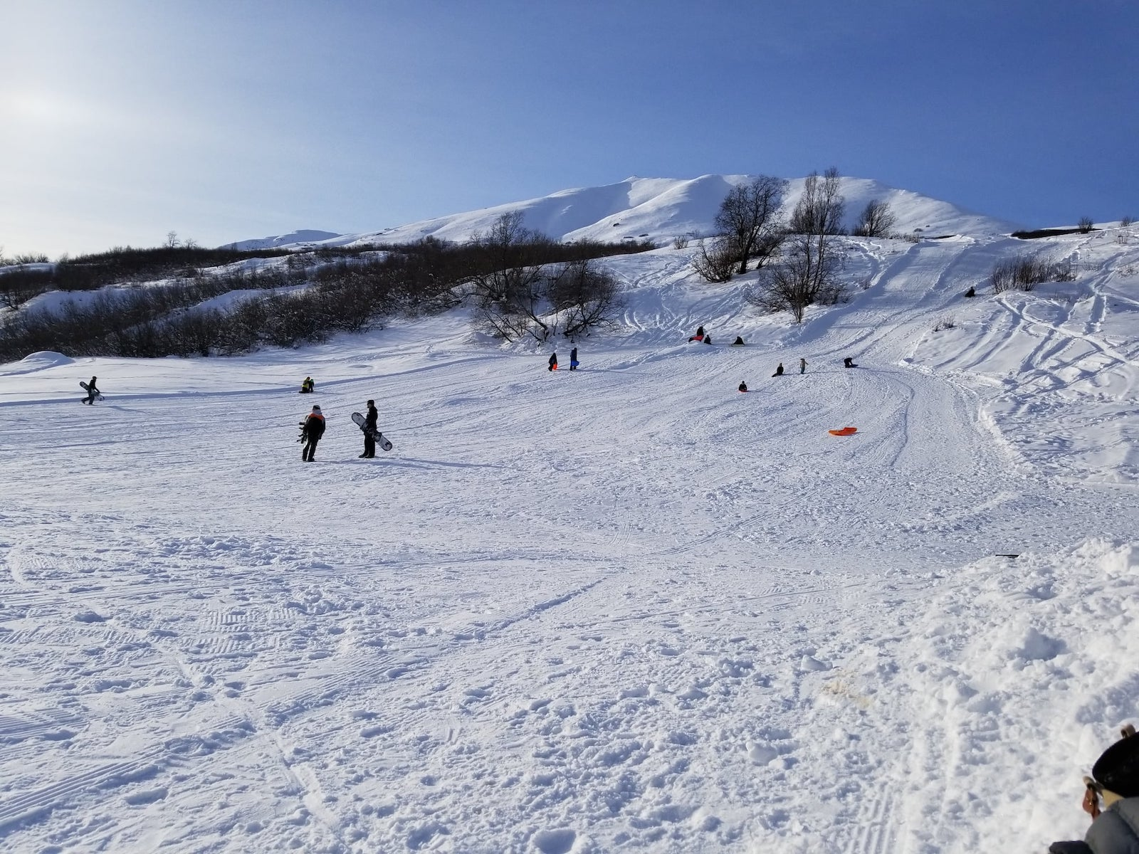 Image of skiers and snowboards on the slopes at Skeetawk Hatcher Pass in Alaska